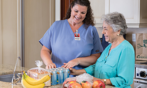 Hawaii senior aging in place with help of home caregiver groceries