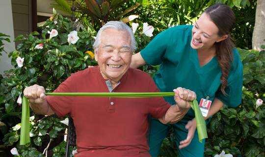 Hawaii senior aging in place with help of home caregiver watching physical therapy