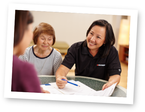 Oahu home care service provider speaking with senior aging in place with help of home caregiver